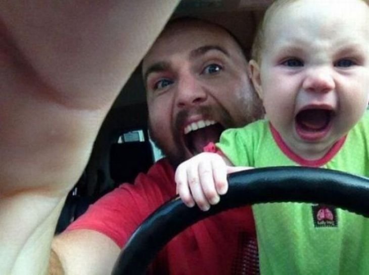 Dad and son driving