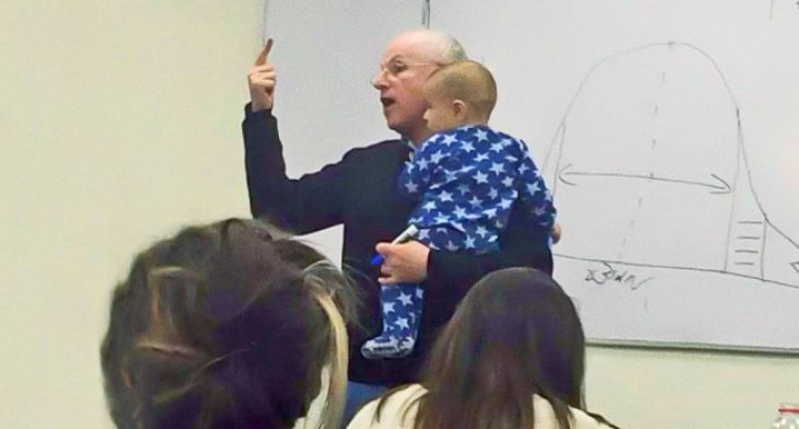 Professor with a baby in his arms